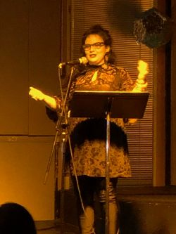 Photo of Dorothea Laskey reading during Little Corner Presents: Excess Women