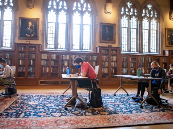 Study Photo: Wearing masks and physically distanced, students study in the Gothic Reading Room of Perkins Library. Photo by Jared Lazarus, Duke University Communications.